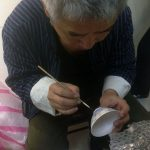 Artista de cerámica en el Chiang Kai-shek M. H.